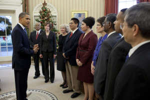 President Barack Obama greets the 2011 Presidential Awards for Excellence in Science, Mathematics and Engineering Mentoring recipients in the Oval Office, Dec. 12, 2011.
