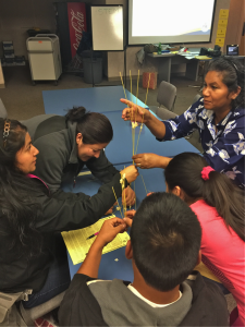 Parents engage in hands-on science experiments